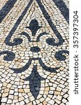 Small photo of Cobblestones Floral Pattern Handmade pavement (Calçada Portuguesa) in Porto, Portugal.