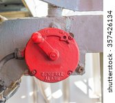 Small photo of Vintage red manual general alarm in oil rig which activate by rotate the lever
