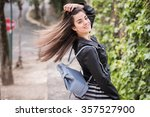 young woman moving her hair in...   Shutterstock . vector #357527900