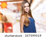 young woman smiling over white... | Shutterstock . vector #357599519
