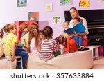 nurse in kindergarten read book ... | Shutterstock . vector #357633884