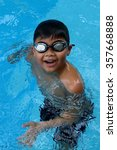 happy young asian kid with swim ... | Shutterstock . vector #357668888