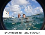 Couple Swimming In The Sea By...