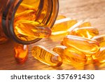 fish oil capsules with omega 3... | Shutterstock . vector #357691430
