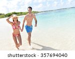 cheerful couple running on a... | Shutterstock . vector #357694040