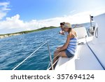 couple sitting on sailboat deck ... | Shutterstock . vector #357694124