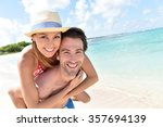 man giving piggyback ride to... | Shutterstock . vector #357694139