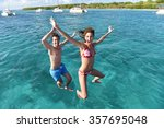 cheerful couple jumping into... | Shutterstock . vector #357695048