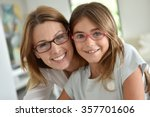 portrait of mother and daughter ... | Shutterstock . vector #357701606