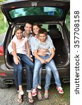 family sitting in car trunk ... | Shutterstock . vector #357708158