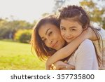 lifestyle portrait mom and... | Shutterstock . vector #357735800