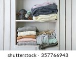 knitting clothes on wooden shelf | Shutterstock . vector #357766943