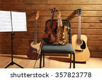 musical instruments on a chair... | Shutterstock . vector #357823778