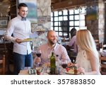happy smiling male waiter... | Shutterstock . vector #357883850