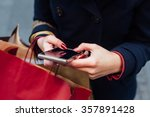 woman in coat using mobile... | Shutterstock . vector #357891428