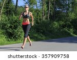 woman jogging barefoot   Shutterstock . vector #357909758