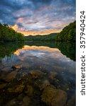 summer sunset reflects on the... | Shutterstock . vector #357940424