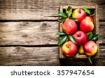 Fresh Red Apples In The Wooden...