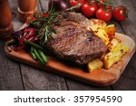 Beef Rib Eye Steak With Roaste...