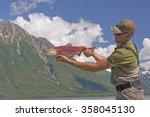 Fisherman Holding A Sockeye...