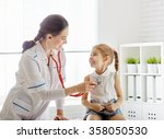 doctor examining a child girl...   Shutterstock . vector #358050530