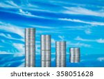 coins on glass with blue sky... | Shutterstock . vector #358051628