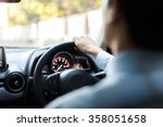 Close Up Of Young Man Driving...