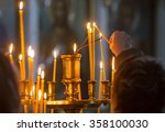 Woman Hand Lighting Candles In...