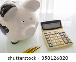 piggy bank with calculator and... | Shutterstock . vector #358126820