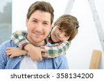 happy father and son making... | Shutterstock . vector #358134200