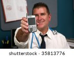 a doctor holds a cell phone represnting technology in the medical fields - stock photo