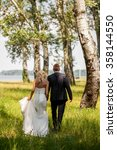 young wedding couple on summer...   Shutterstock . vector #358144550
