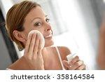 Woman In Bathroom Cleansing...