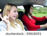 two happy women in a car - stock photo