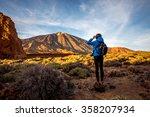 female traveler in teide park   Shutterstock . vector #358207934