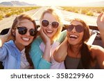 three female friends on road... | Shutterstock . vector #358229960