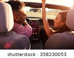 couple on road trip driving in... | Shutterstock . vector #358230053