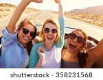 three female friends on road... | Shutterstock . vector #358231568