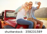 couple on road trip sit on... | Shutterstock . vector #358231589