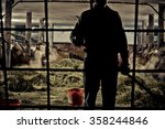 Farmer Infront Of His Cows
