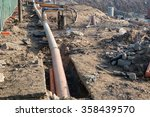 Small photo of Dewatering system on construction site, showing deep well and collection line hookup. Dewatering wellpoint system. Selective focus.