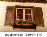 a window with open shutters... | Shutterstock . vector #358444940