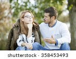 young couple arguing outdoor  | Shutterstock . vector #358453493