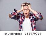 shocked dazed young man in... | Shutterstock . vector #358479719