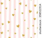 Stock vector gold glittering heart confetti seamless pattern on striped background 358522514