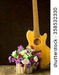 Guitar And Flower On Still Lif...