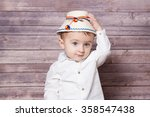 portrait of a 1 year old baby... | Shutterstock . vector #358547438