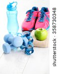fitness concept with dumbbells... | Shutterstock . vector #358730348