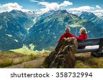 Stock photo healthy and vital senior couple sitting on bench in austrian alps with beautiful view 358732994