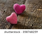 two knitting hearts on old...   Shutterstock . vector #358768259